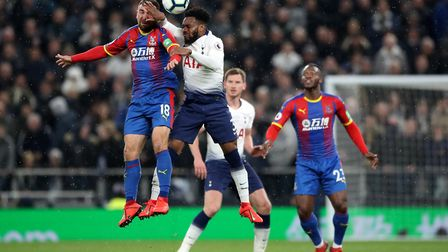 Crystal Palace's James McArthur (left) and Tottenham Hotspur's Danny Rose battle for a header during