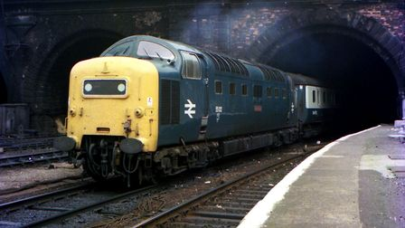 """Class 55 """"Deltic"""" diesel locomotive No. 55 012 """"Crepello"""" enter the environs of Kings Cross Station,"""