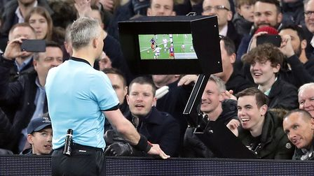 Referee Bjorn Kuipers consults VAR before awarding Manchester City a penalty during the Champions Le