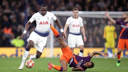 Tottenham Hotspur's Moussa Sissoko (left) and Manchester City's Raheem Sterling battle for the ball