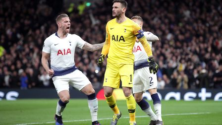 Tottenham Hotspur goalkeeper Hugo Lloris (centre) is congratulated by Toby Alderweireld (left) after