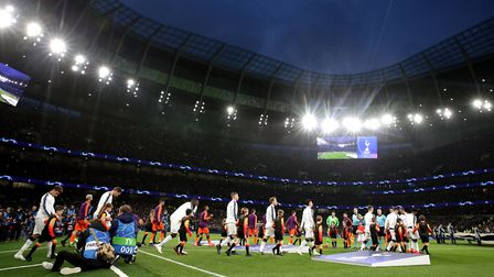 The Tottenham Hotspur and Manchester City players walk out for the Champions League quarter-final, f