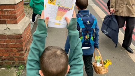 Children help the NW3 Green School Runs team hand out leafets in Hampstead. Picture: NW3GSR