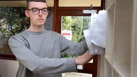Teddy Eastoe at his mailbox in the communal entrance hall of the flats on Upper Park Road. Picture: