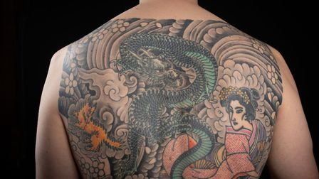 Nick Hurst's tattoo is based in Japanese woodblock prints which feature in his book picture by Anna