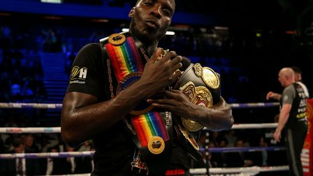 Lawrence Okolie celebrates beating Wadi Camacho during their British and Commonwealth Championship b