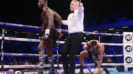 Lawrence Okolie is ushered away from Wadi Camacho (pic Natalie Mayhew, Butterfly Boxing)