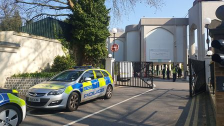 Police cars at Regent's Park Mosque this morning, after a man was stabbed to death nearby last night