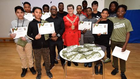Teenagers collect their certificates from Hackney Speaker Cllr Clare Potter and Yasuke Project organ