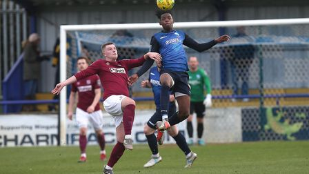 Keegan Cole of Potters Bar Town and Wingate & Finchley's Donovan Makoma battle for the ball (pic: Ga