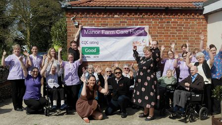 Staff and residents at Manor Farm Care Home celebrate their 'Good' rating. Picture: Courtesy of Mano