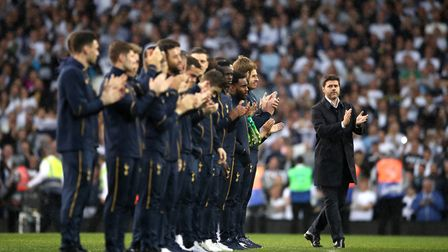 Tottenham Hotspur manager Mauricio Pochettino and his players applaud the former players as they are