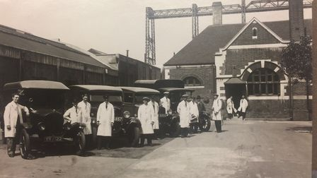 Vehicles and staff engaged in disinfectation in 1935. Photo show the rear entrance to the disinfecti