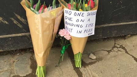 Flowers at the site of Stephen Hampton's death in Swain's Lane. Picture: Nathalie Raffray