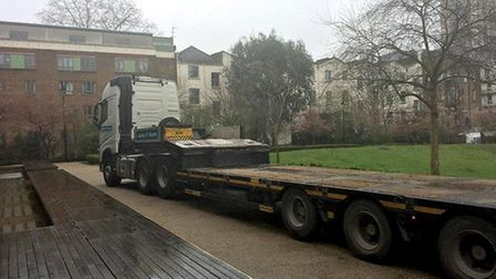 An articulated lorry carrying a 14 tonne excavator, turned into the Hampstead Theatre terrace. Pictu