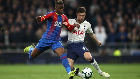 Crystal Palace's Wilfried Zaha (left) and Tottenham Hotspur's Ben Davies battle for the ball during