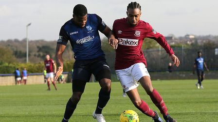 Dernell Wynter of Potters Bar and Wingate & Finchley's Ola Williams battle for the ball (pic: Gavin