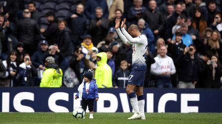 Spurs forward Lucas Moura plays football with his son Miguel after the Premier League match against