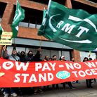RMT members who include cleaners on London Overground trains demonstrate outside Overground House 12
