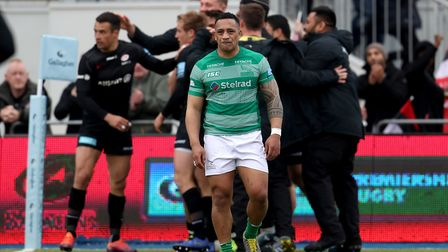 Newcastle Falcons' Sinoti Sinoti looks dejected as Saracens celebrate Sean Maitland scoring a try du