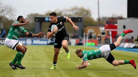 Saracens' Sean Maitland runs between Newcastle Falcons' Alex Tait and Vereniki Goneva (pic: Bradley