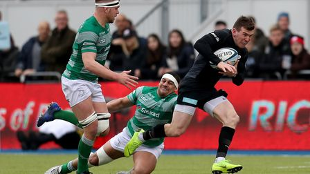 Saracens' Ben Spencer is tackled by Newcastle Falcons' Josh Matavesi (pic: Bradley Collyer/PA)