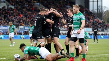 Saracens' Max Malins celebrates with his team mates after he scores a try against Newcastle Falcons