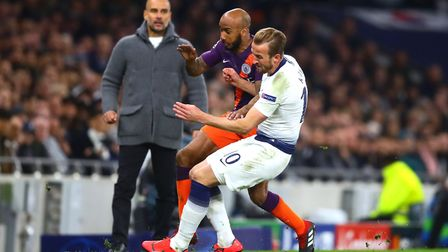 Tottenham Hotspur's Harry Kane (right) tackles Manchester City's Fabian Delph, resulting in a injury