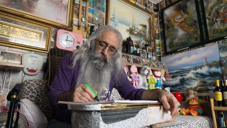 Veysel Baba, pictured in his living room, has spent ten years building up his collection. Picture: V