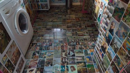 Even the kitchen floor at the 'Sistine Chapel London' is covered in art prints. Picture: Veysel Baba