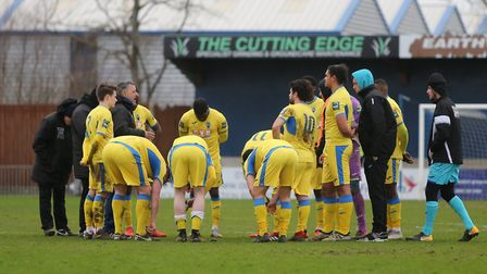 Haringey Borough players talk at the end of their Bostik Premier match (pic: George Phillipou/TGS Ph