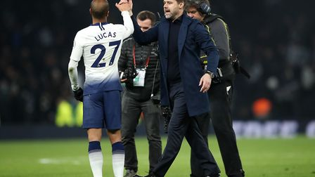 Tottenham Hotspur manager Mauricio Pochettino congratulates team-mate Lucas Moura after the final wh