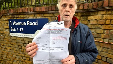 James Walsh with his court summons for non payment of council tax. Picture: Polly Hancock