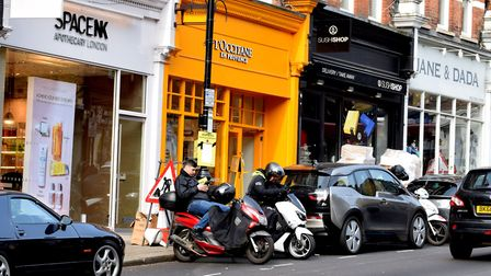 Moped delivery drivers at the top of Hampstead High St NW3
