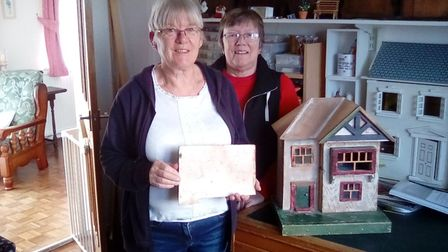Gwen Head and Val Hobbs with the doll's house and the sketch. Picture: Val Hobbs