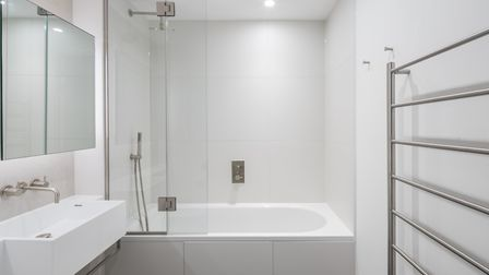 Bathrooms include Laufen basins, wall-hung WCs with concealed cisterns