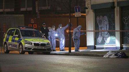 Forensic officers and police at the scene. Picture: Yui Mok/PA Wire