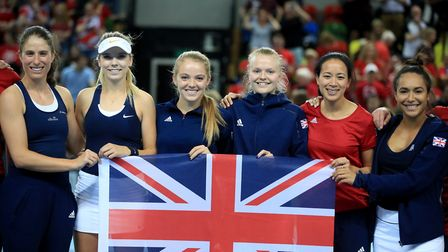 The Great Britain team celebrate during day two of the Fed Cup at the Copper Box, London.
