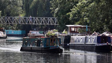 A narrow boat moves along the River Lea. Picture: Gareth Fuller