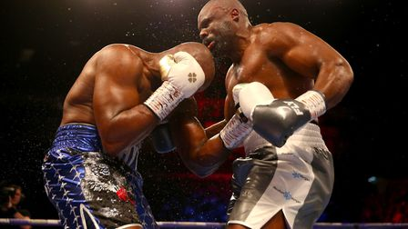 Dereck Chisora (right) goes on the attack against Dillian Whyte (pic: Steven Paston/PA)