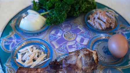 A traditional Passover seder plate including lamb shankbone, egg, bitter herbs, charoset paste and k