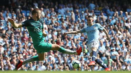 Tottenham Hotspur's Eric Dier (left) charges down a shot by Manchester City's Phil Foden during the