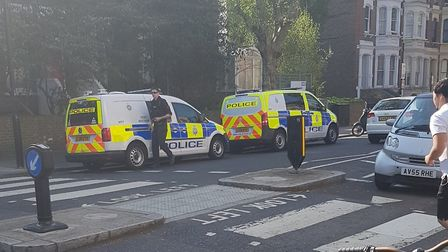Police outside of Maida Vale underground station after a serious assault on Easter Sunday. Picture: