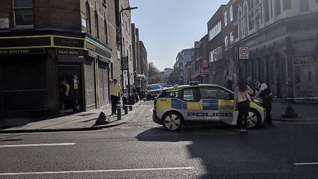 Police at the scene in Arcola Street. Picture: @999London