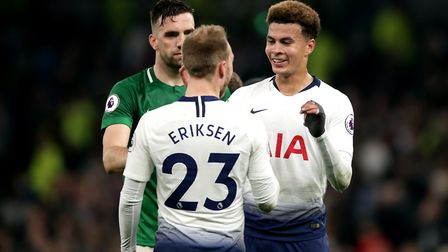 Tottenham Hotspur's Christian Eriksen (left) and Dele Alli celebrate after the final whistle followi