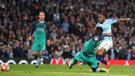 Manchester City's Raheem Sterling (right) scores his side's fifth goal, but it is later ruled out fo