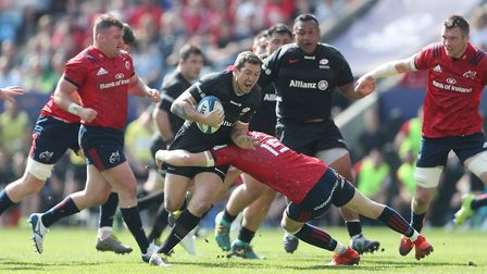Saracens' Alex Goode is tackled by Munster's Mike Haley during the European Champions Cup semi final
