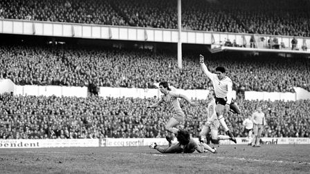 Coventry City goalkeeper Les Sealey dives in vain as Tottenham Hotspur's Chris Hughton scores at Whi