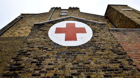 The British Red Cross building on the corner of Graham Road and Dalston Lane, with its distinctive R