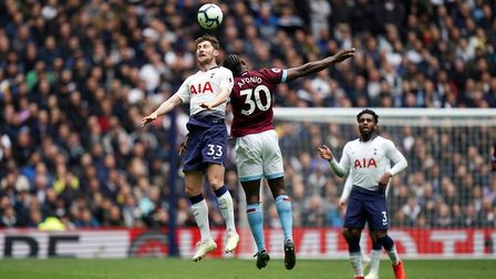 Tottenham Hotspur's Ben Davies and West Ham United's Michail Antonio battle for the ball during the